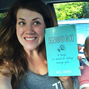 Kate enjoying her new author status...in her minivan with a toddler on her lap!
